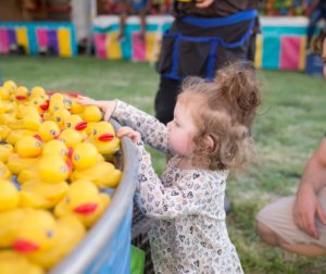 Anora ( Age 2) picks out a duckie, with father Alec watching nearby. (Lisa Robinson photo)