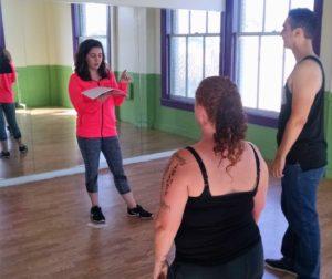 Maddi Alipaz instructs Lynn Love and Jesus Jaramillo on movement for a scene.