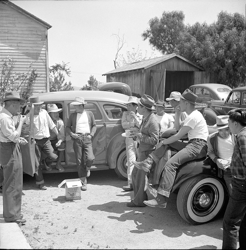 Local Japanese-American men standing outside the Japanese Hall in San Juan, May 1942. Photo courtesy of the Russell Lee collection at the Library of Congress.