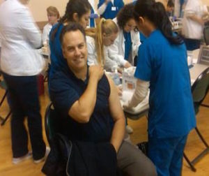 San Benito County Sheriff Darren Thompson getting his Flu Shot. Photo Courtesy of  the San Benito County Health and Human Services Agency
