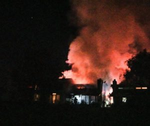 Eighteen firefighters brought fire under control in less than an hour. Photo and video by Steve Loos.