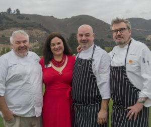 Photo of the dinner's three chefs and the event host.