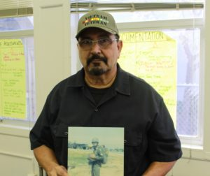 Vietnam Vet, Anthony Gutierrez holds up photo of himself in Vietnam. Photos by Jordan Ramos