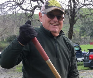Jim Ostdick shoveling holes for trees being planted at the Historical Park in spring 2017. Photo by Anita Kane