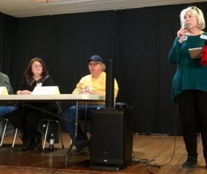 "Maureen Cain, right, of the Aromas Progressive Action League, addresses the audience at a panel discussion the group hosted titled ""Local Democracy Dies in Darkness."" Three local journalists made up the panel. They are Mark Paxton, left, Julia Reynolds Martinez and Wayne Norton."