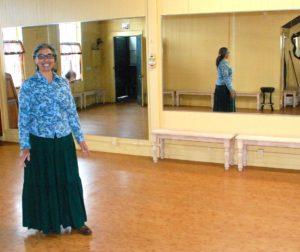 Ramona Hill stands in the dance studio and performance area at Credo Studio in San Juan Bautista.