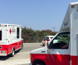 Photo of Red Cross Central Coast emergency response vehicles leaving the Santa Cruz office to respond to a disaster call.