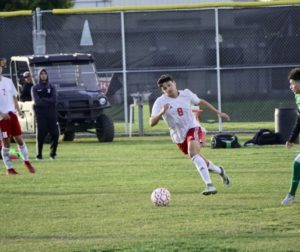 Senior Abel Rivera changing his speed to chase the ball.  Photos by Elliot Ruiz