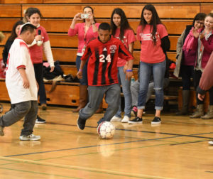 A Gifted Soccer match held in the O'Donnell Gym. The lunchtime soccer matches feature Life Skills students and are held indoors when the weather is poor or outdoor on a lawn of the main campus so students can cheer on the participants. Photo by Ed Wong.