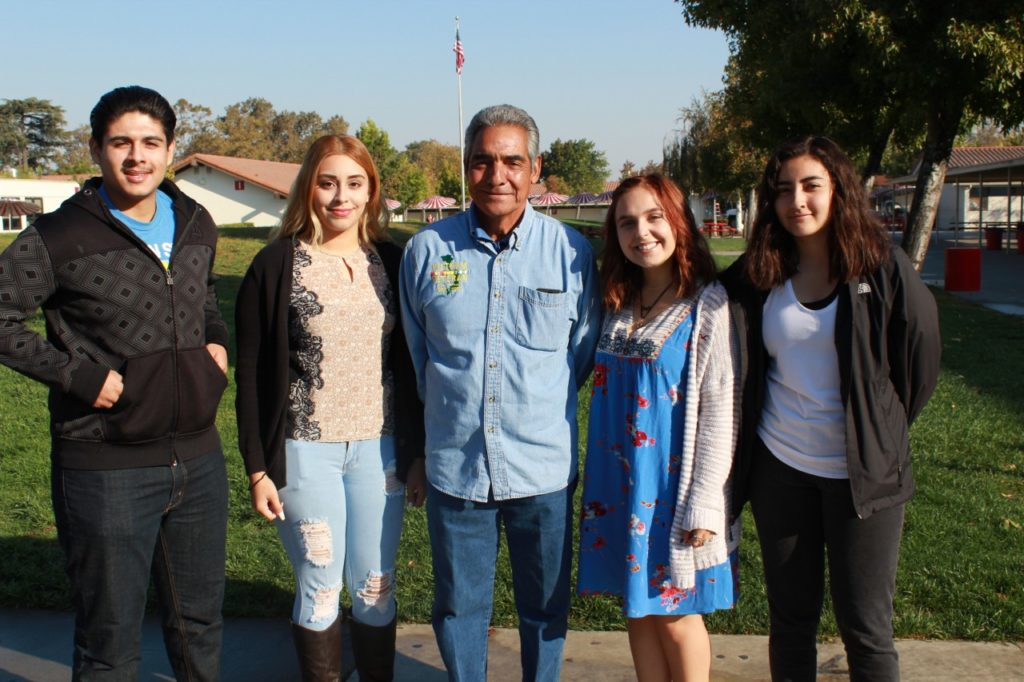 Bernie Ramirez with students. Photo provided.