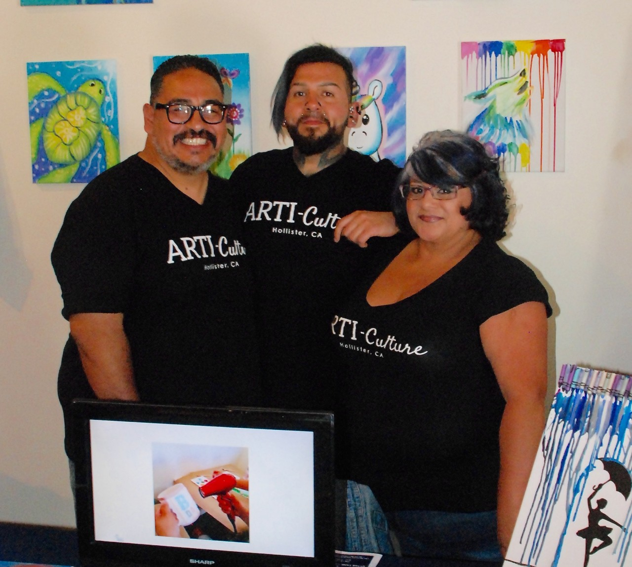 Joel Esqueda, center, founder of ARTI-Culture, with Rolan Resendiz and Lynda Reyna at the annual Startup Challenge Monterey Bay Saturday in Salinas. ARTI-Culture won a $2,500 runner-up prize. Photo by Tom Leyde.