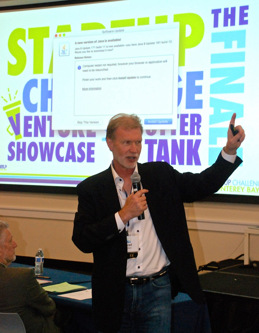 Brad Barbeau, executive director of the Institute for Innovation and Economic Development at CSUMB, talks to the audience before the Otter Tank presentations at the annual Startup Challenge Monterey Bay Saturday in Salinas. Photo by Tom Leyde.