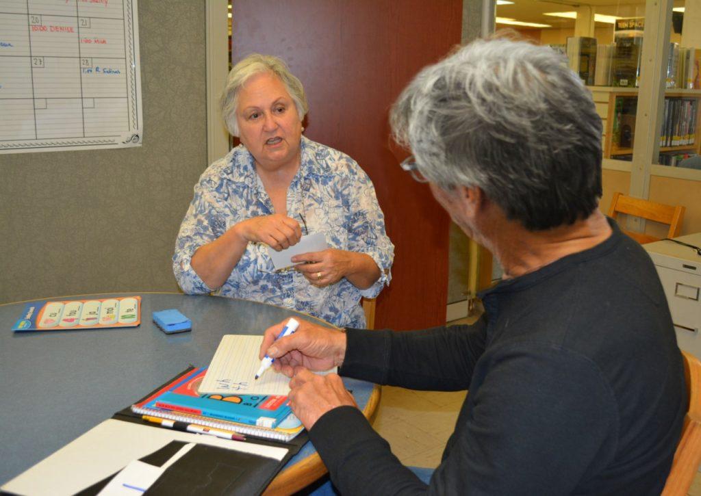 Rebecca Salinas tutoring at the San Benito County Free Library. File Photo.