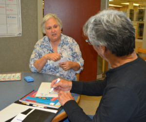 Rebecca Salinas tutoring at the San Benito County Free Library. File Photo.