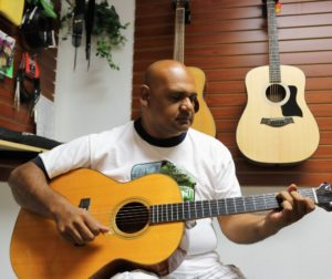Oscar Rivera may not read music, but he has no problem bringing it out of a restored guitar. Photos by John Chadwell.