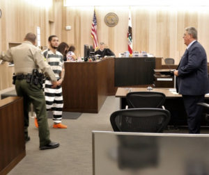 As his court-appointed attorney Greg LaForge waits, Jose Barajas is led into the courtroom. Photos by John Chadwell.