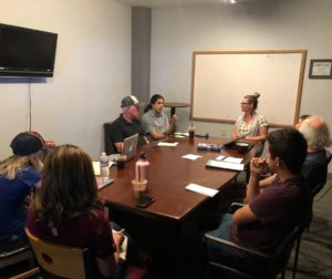 Our team of reporters discussing story ideas at the weekly BenitoLink meeting. Photo by Laura Romero.