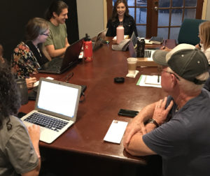 The weekly News Editorial meeting. (Left to Right) Team members Laura Romero, Carmel de Bertaut, Becky Bonner, Nicholas Preciado, Diviana Navarro, Blaire Strohn, Paul Hersh and John Chadwell. Photo by Leslie David.