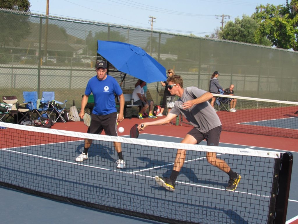 Ken Ottmar (left) and Cameron Fitzpatrick playing pickleball during the grand opening. Photo by Noe Magaña.