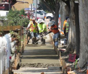 City crews smooth out fresh cement during sidewalk replacement efforts in Hollister. Photo by Noe Magaña.