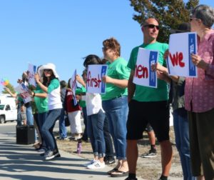 Local teachers took to the streets earlier this summer to show unity over pay negotiations. Photo by John Chadwell.