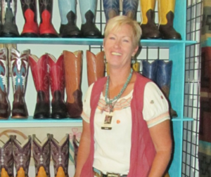 Kelly Martin shows boots in the Vaquero Days vendor booth in 2016. File photo