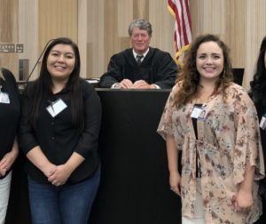 2018 Summer Advocate Training class is sworn in by Hon. Judge Tobias. Pictured L to R: Donna Hagins, Miriam Morales, Sarah Gutierrez, and Alma Smith. Photo provided by CASA.