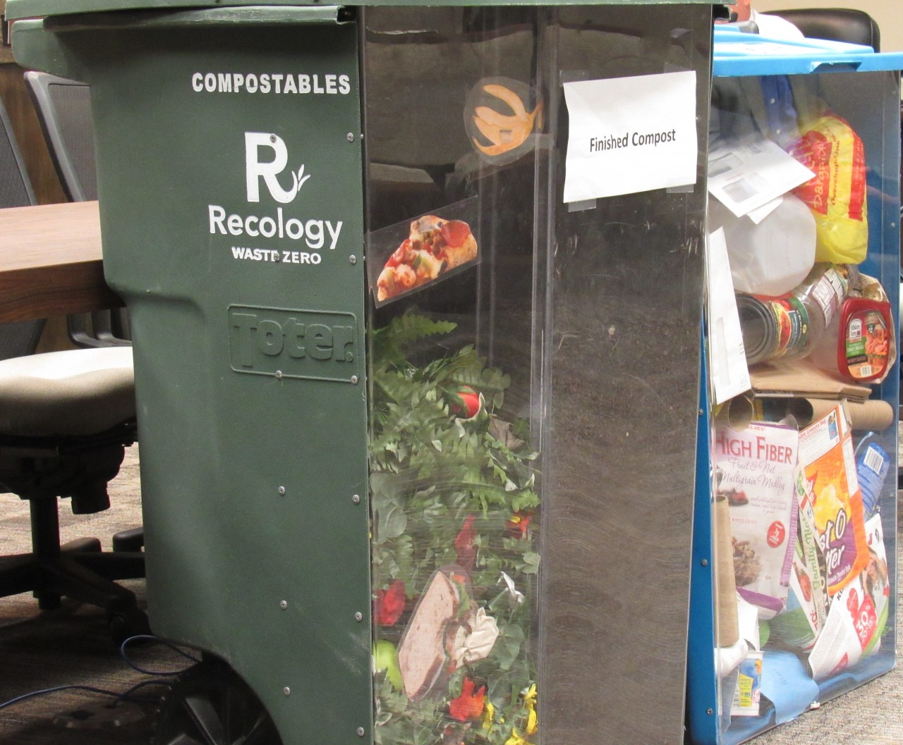 Carts on display by Recology. The green cart is part of the bundle of new rates. Photo by Noe Magaña.