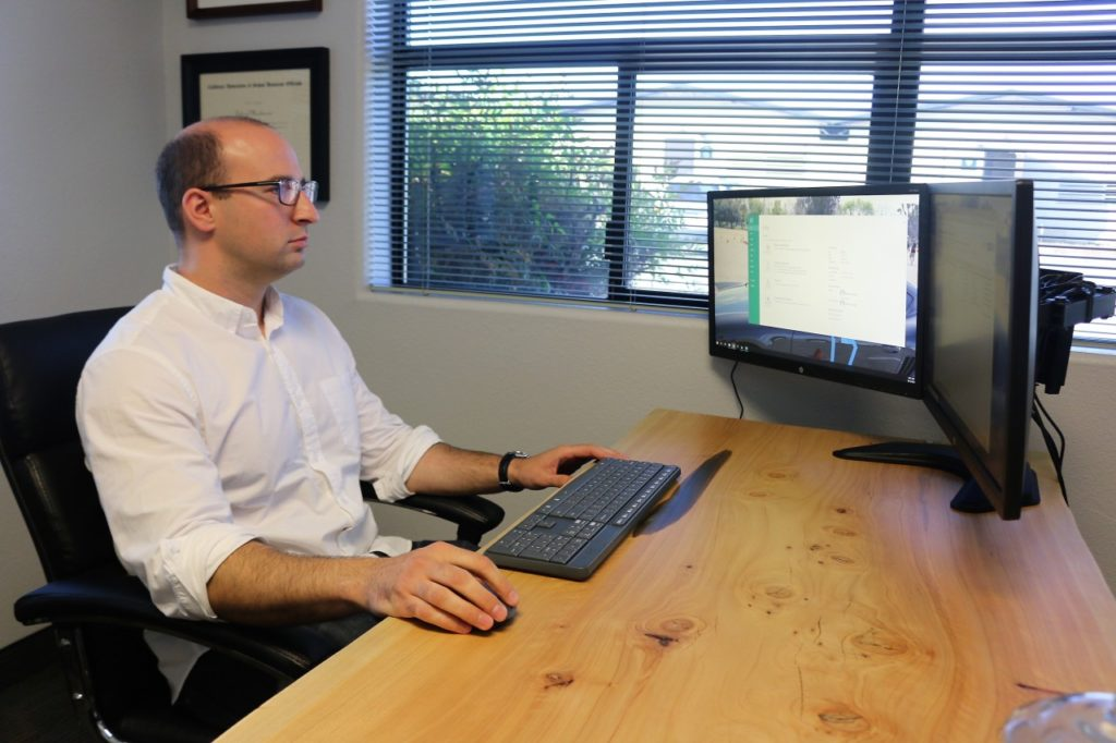 In a little over a year of reconciling accounts, Gabriel Moulaison found 175 accounting errors. Photo by John Chadwell.