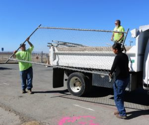 Hollister city crew erects 128 feet of fence cordoning off dog park and picnic area at Hollister Municipal Airport where large anomalies were detected. Photos by John Chadwell.