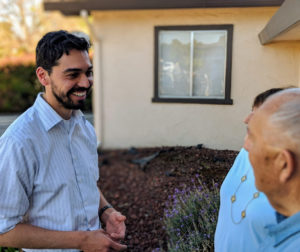 Omar Rodriguez speaks with voters while campaigning for the open Superior Court Judicial seat. Photo provided.