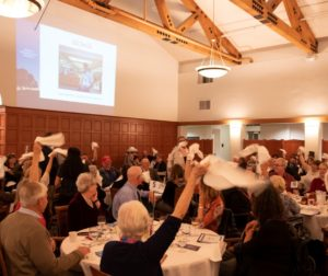 Attendees showed support of honorees by waving their napkins in the air. Photo courtesy of Marisa Duran photograpy.