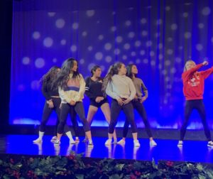 A group of students from Dance C performs a hip hop routine during dance rehearsal.