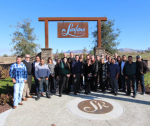 The Anderson Homes team standing in front of Santana Ranch, a new subdivision just off Fairview Rd. in Hollister. Photo provided.