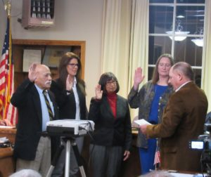 Newly elected Councilmembers (left to right) Cesar Flores, Leslie Jordan and Mary Edge, along with City Clerk Laura Cent being sworn in by San Benito County Supervisor Anthony Botelho. Photo by Noe Magaña.
