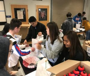 San Benito High School sophomore AVID students helped fill bags with donated items to be delivered to the homeless shelter on Dec. 19. Photo by Adam Breen.