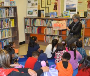 Children being read to during story time at the San Benito County Free Library. Photo provided.