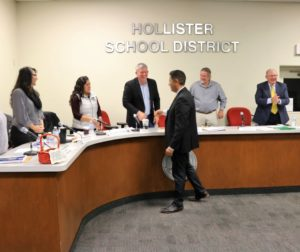 Diego Ochoa thanks each member of the Hollister School District Board of Trustees after their unanimous vote to approve him to a four-year term as superintendent. Photo by John Chadwell.
