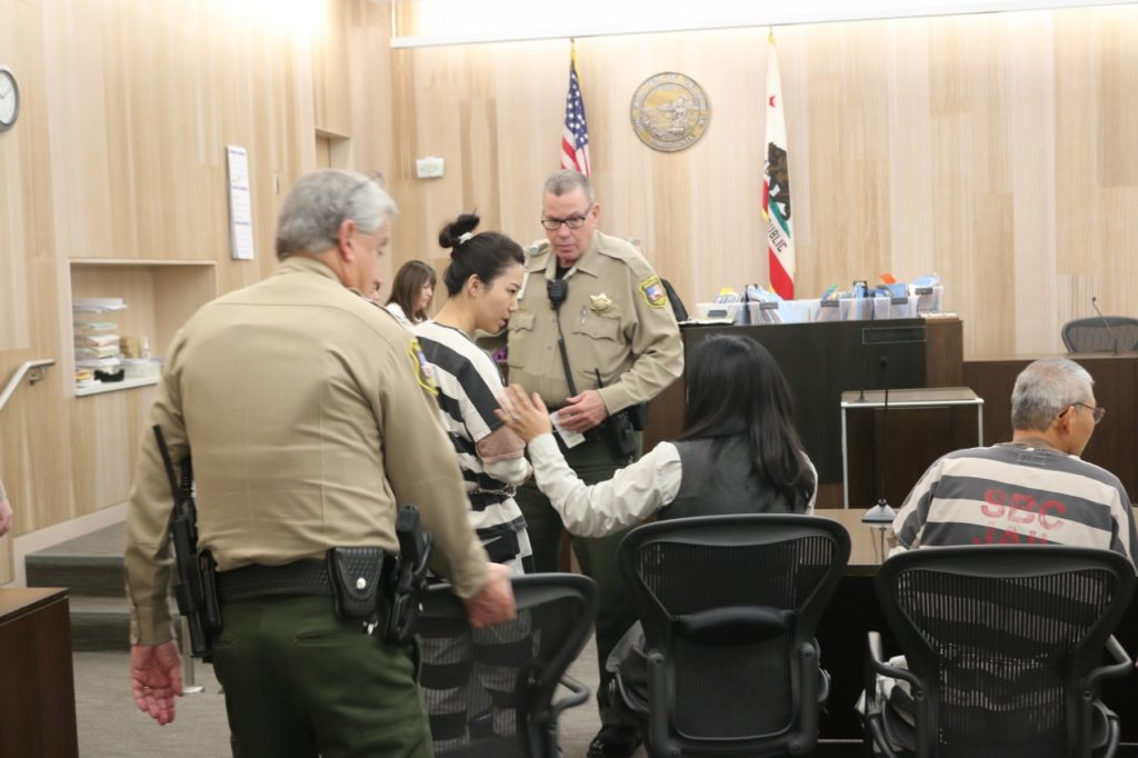 Jung Choi (left) and Sang Ji (right) have appeared in court together for over a year. A Korean interpreter sits between them at a 2018 hearing. Photo by John Chadwell.