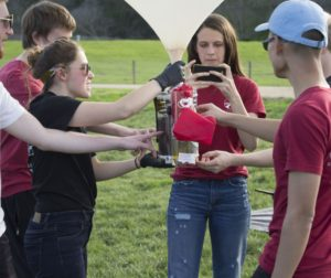 The Stanford Student Space Initiative (SSSI) team members touch the canister before launch. Photo by Noe Magaña.