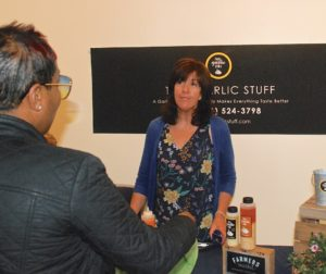 2018 winner Michelle Doty talks about her company, That Garlic Stuff, to a woman attending the ninth annual Startup Challenge Monterey Bay in Salinas last year. Doty won the Main Street division and a prize of $10,000. File photo by Tom Leyde.