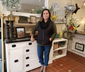 Rustic Charm owner Stephanie Diaz-Kotel. The furniture and home decor store opened Jan. 26. Photo by Carmel de Bertaut.