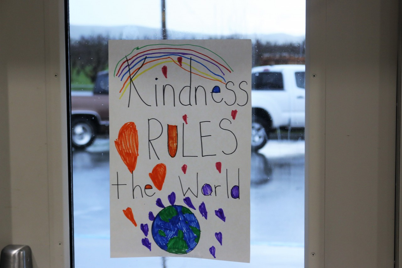 Kindness poster on gym door at Ladd Lane. Photo by John Chadwell.