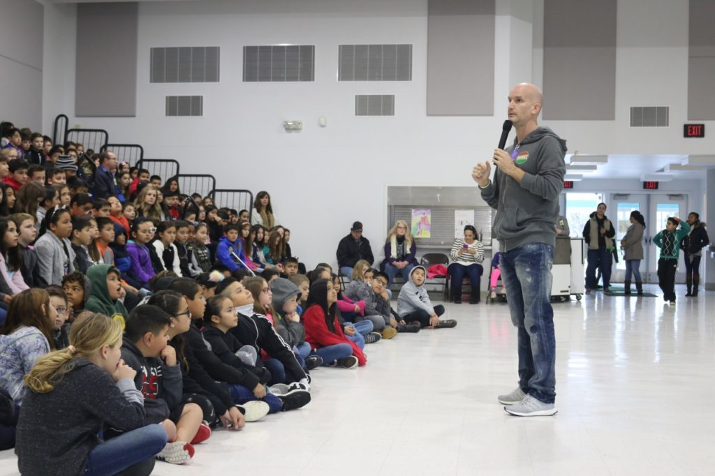 Leon Logothetis, host of the Kindness Diaries show on Netflix, told nearly 200 Ladd Lane students how he was bullied in school and how the kindness of one boy saved him. Photos by John Chadwell.