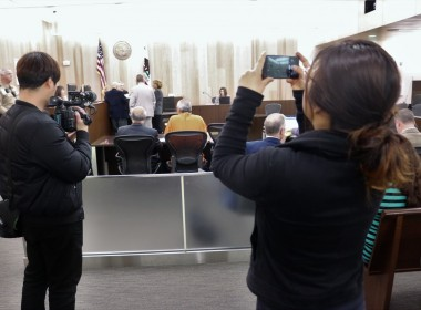 The South Korean news team records Ji's and Choi's court appearance on Feb. 21. Photo by John Chadwell.