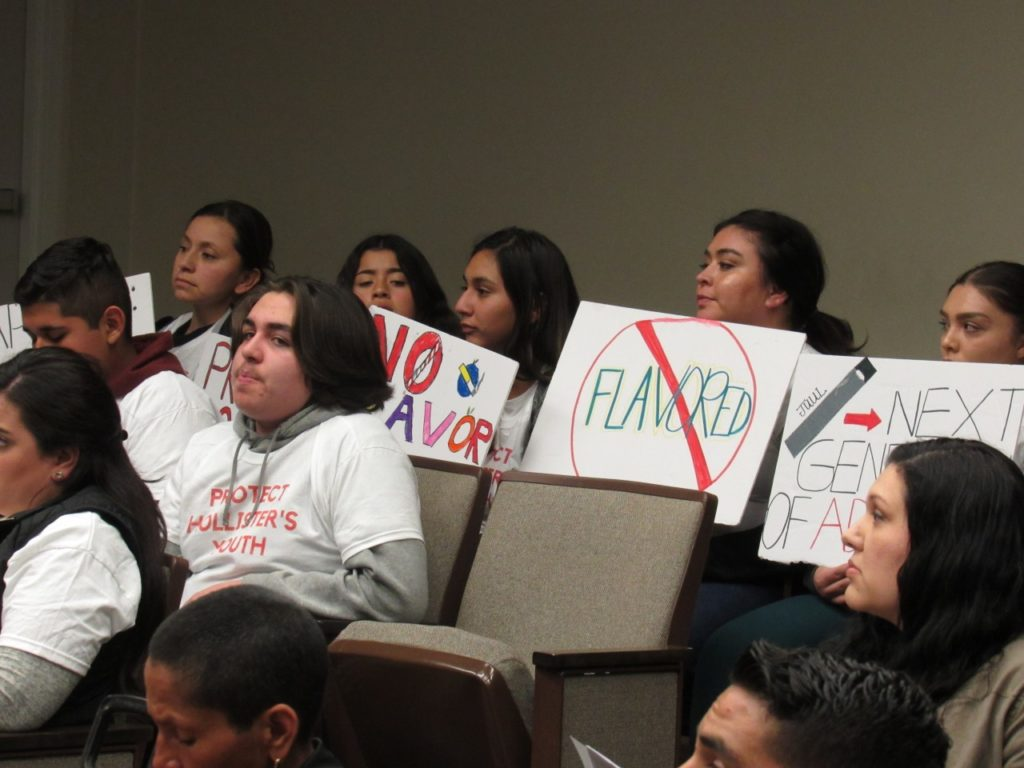 Members of the public holds signs in favor of a flavored tobacco ban during the Feb. 4 Hollister City Council meeting. Photo by Noe Magaña.