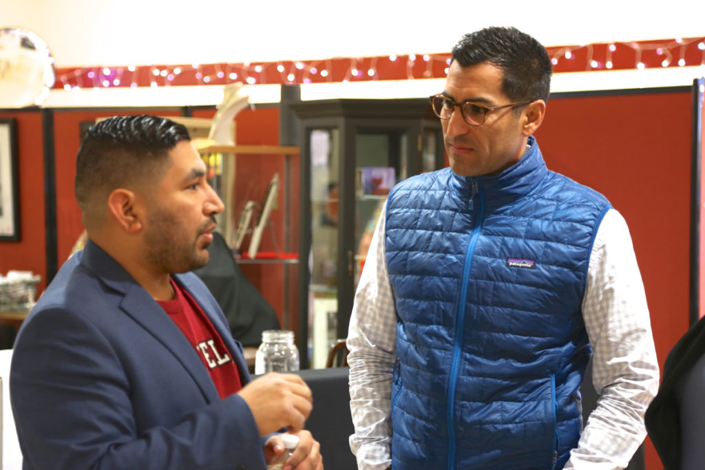 Recently elected Assemblyman Robert Rivas (right) viewed the photo exhibit and spoke to people who attended the event in Gilroy. Photo by Leslie David.