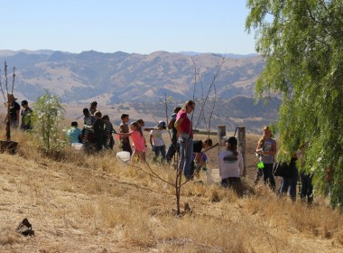 Students planting a pollinator hedgerow. Photo courtesy of Karminder Brown/SBWLG.