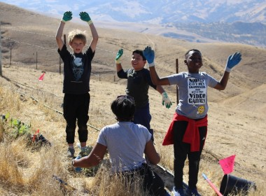 Students feeling triumphant after planting their plant. Photo courtesy of Karminder Brown/SBWLG.