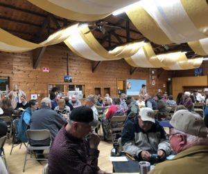 Friends and neighbors gather at Tres Pinos Church Hall on March 9 to try their hand at Pedro, a local card game. Photo by Blaire Strohn.